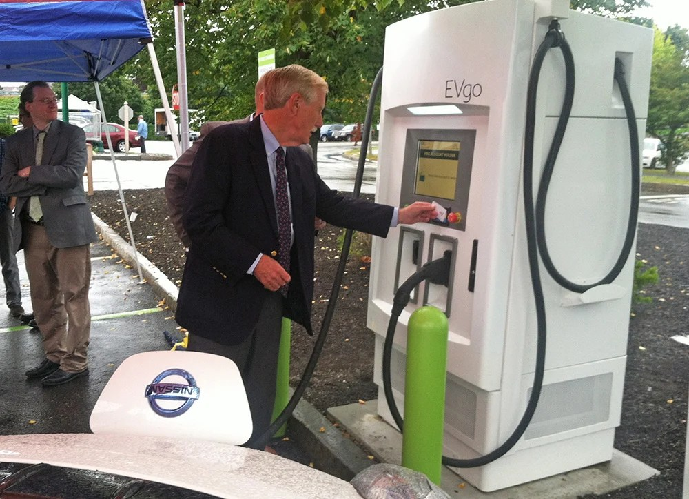 Sen. Angus King uses a high-speed charging kiosk Friday at the Forest Avenue Hannaford store in Portland. He says electric transportation powered by renewable energy is essential to cut greenhouse gas emissions and curb the effects of climate change.