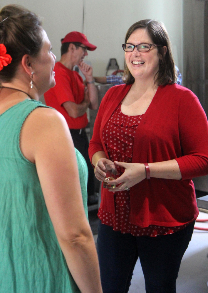 Democrat Emily Cain chats with Norway Brewing Co. co-owner Erika Melhus while campaigning Aug. 26 in Oxford County.