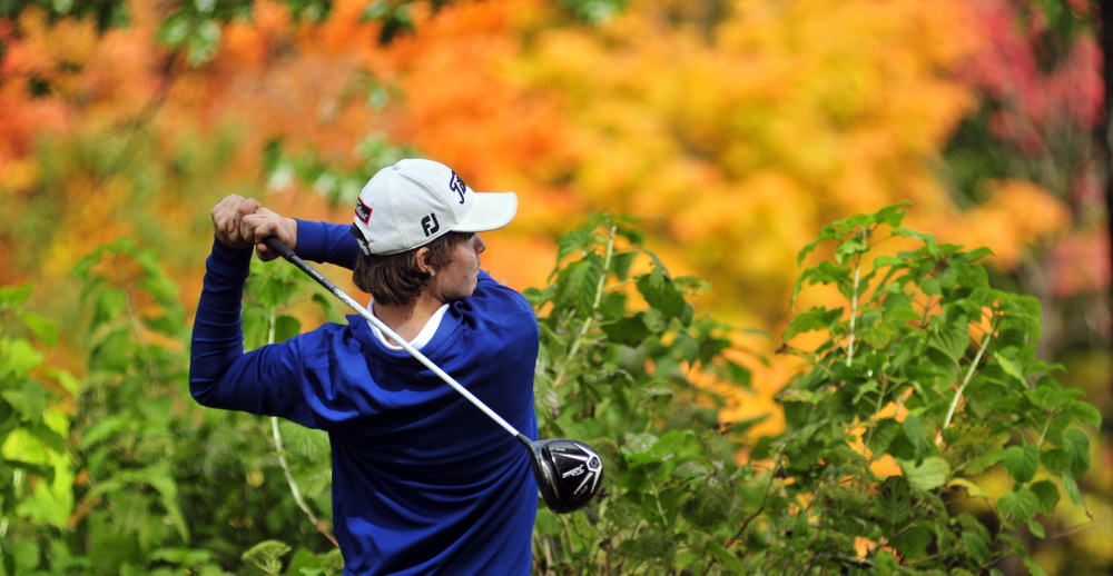 Joe Phelan/Kennebec Journal Erskine Academy golfer Connor Paine tees off on Arrowhead's 18th hole during state team golf championship on Saturday at Natanis Golf Course in Vassalboro.