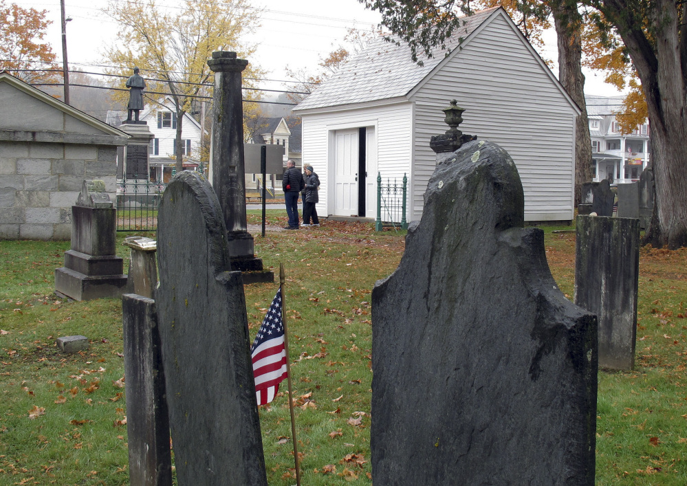 The hearse house, right, and town tomb, left, stand at the entrance to the Brookside Cemetery in Chester, Vt., and remind of a lost tradition both grim and stately.