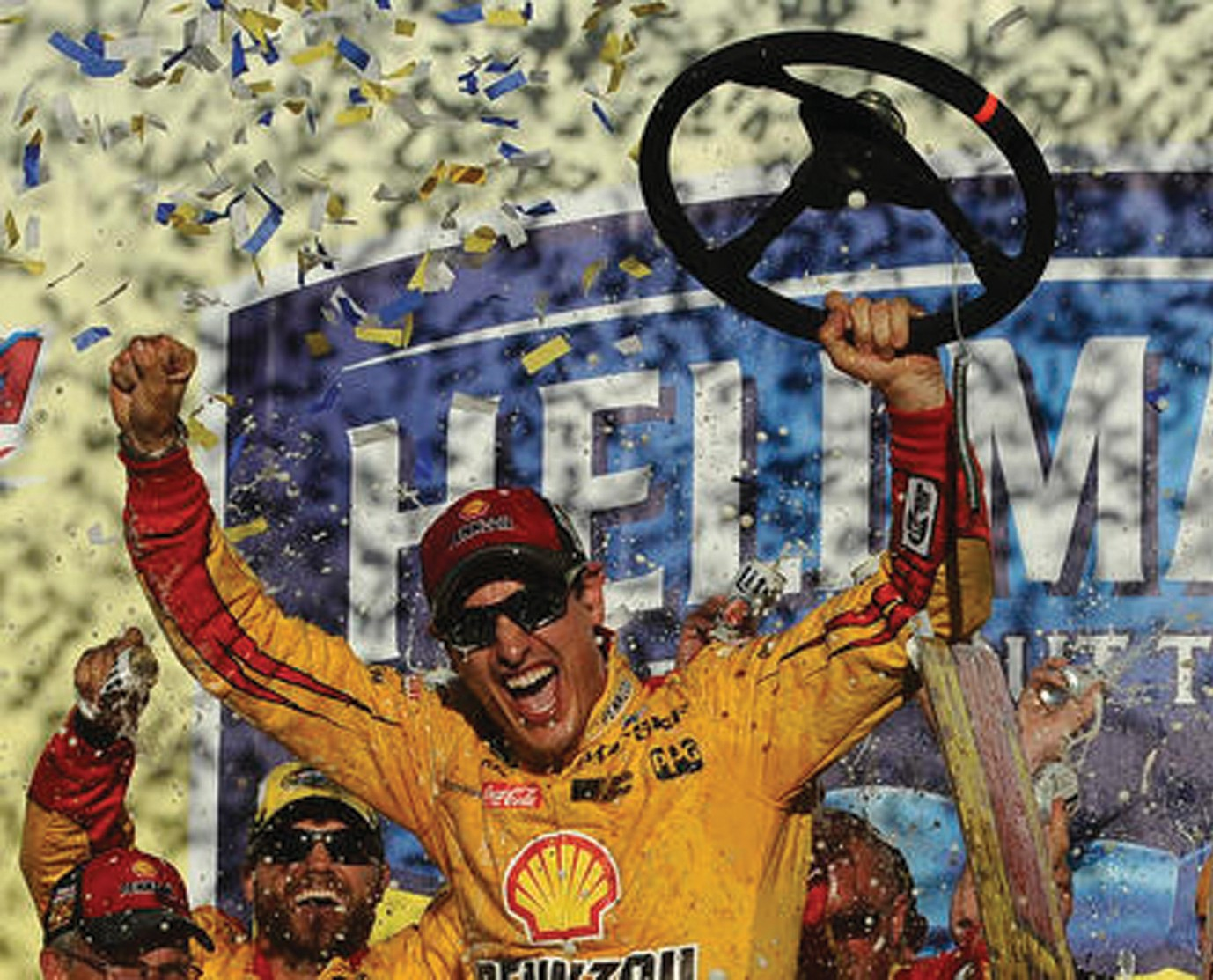 Joey Logano celebrates after winning the NASCAR Sprint Cup Series auto race auto race at Talladega Superspeedway, Sunday, Oct. 23, 2016, in Talladega, Ala.