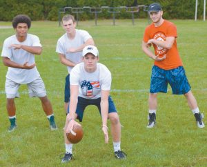 BRUNSWICK HIGH SCHOOL varsity quarterback Christian Jensen (center with ball) has many options when it comes to handing the ball off in the backfield. Ben Palizay, top left, Jesse Devereaux, center, and Hunter Garrett will all be in action tonight as the Dragons host Brewer at 7 p.m. in a battle of 5-0 teams.