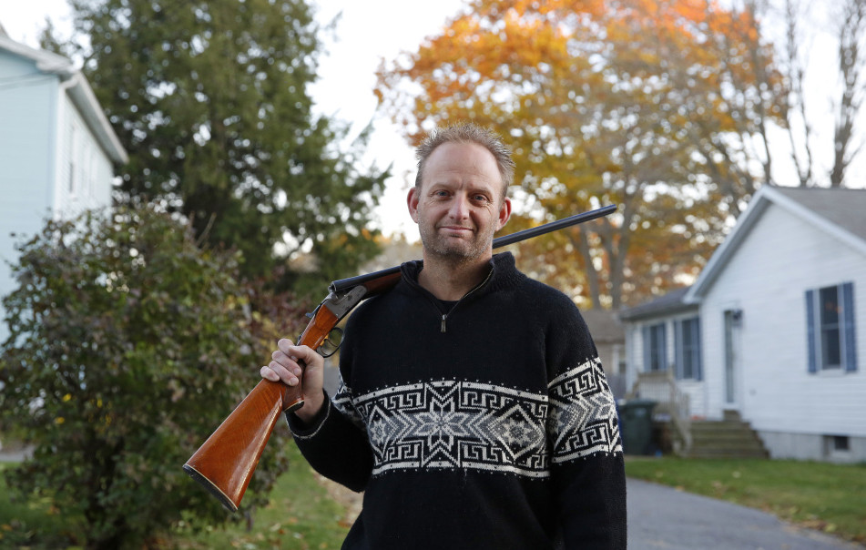 Mark Mayone of South Portland holds the .410 double-barreled shotgun that he says he could not lend to his friend's son without a background check if Question 3 passes. He plans to vote against Question 3, largely because of that requirement.