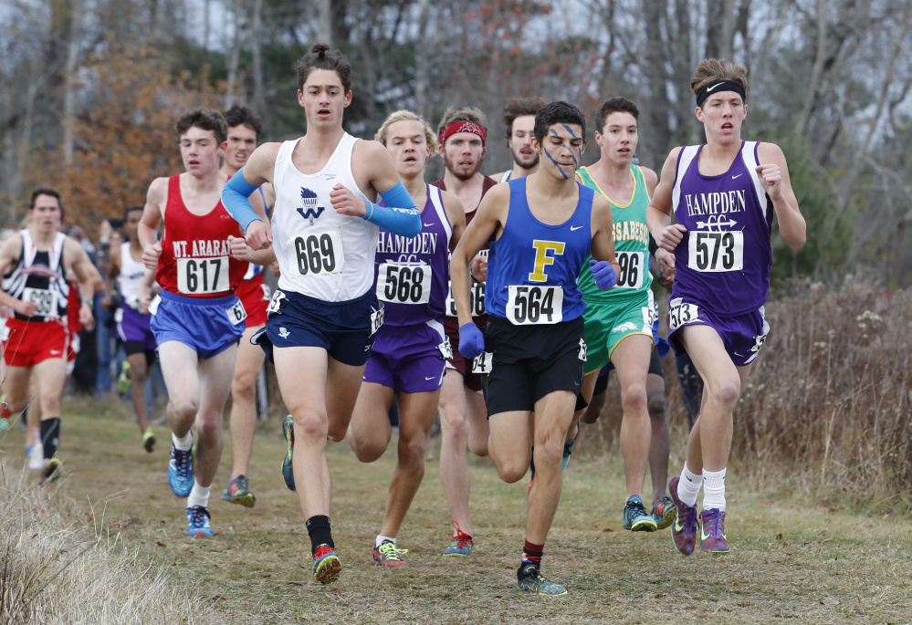 Runners are closely packed during the Class A boys' state championship race Saturday in Belfast.