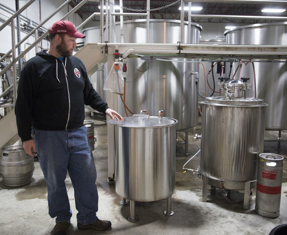 Peter Heggeman, head brewer at D.L. Geary Brewing Co., is shown in November with the brewing system that makes small craft batches for Geary's tasting room. The company is being sold to a Freeport businessman after more than 30 years of ownership by the Geary family.