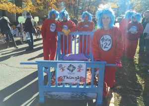 """IN THE PHOTO above, the folks from Independence Association of Maine pose with their Dr. Seuss-themed bed. On the left, Curtis Memorial Library employees pose next to their """"Where the Wild Things Are""""-themed bed on Saturday."""
