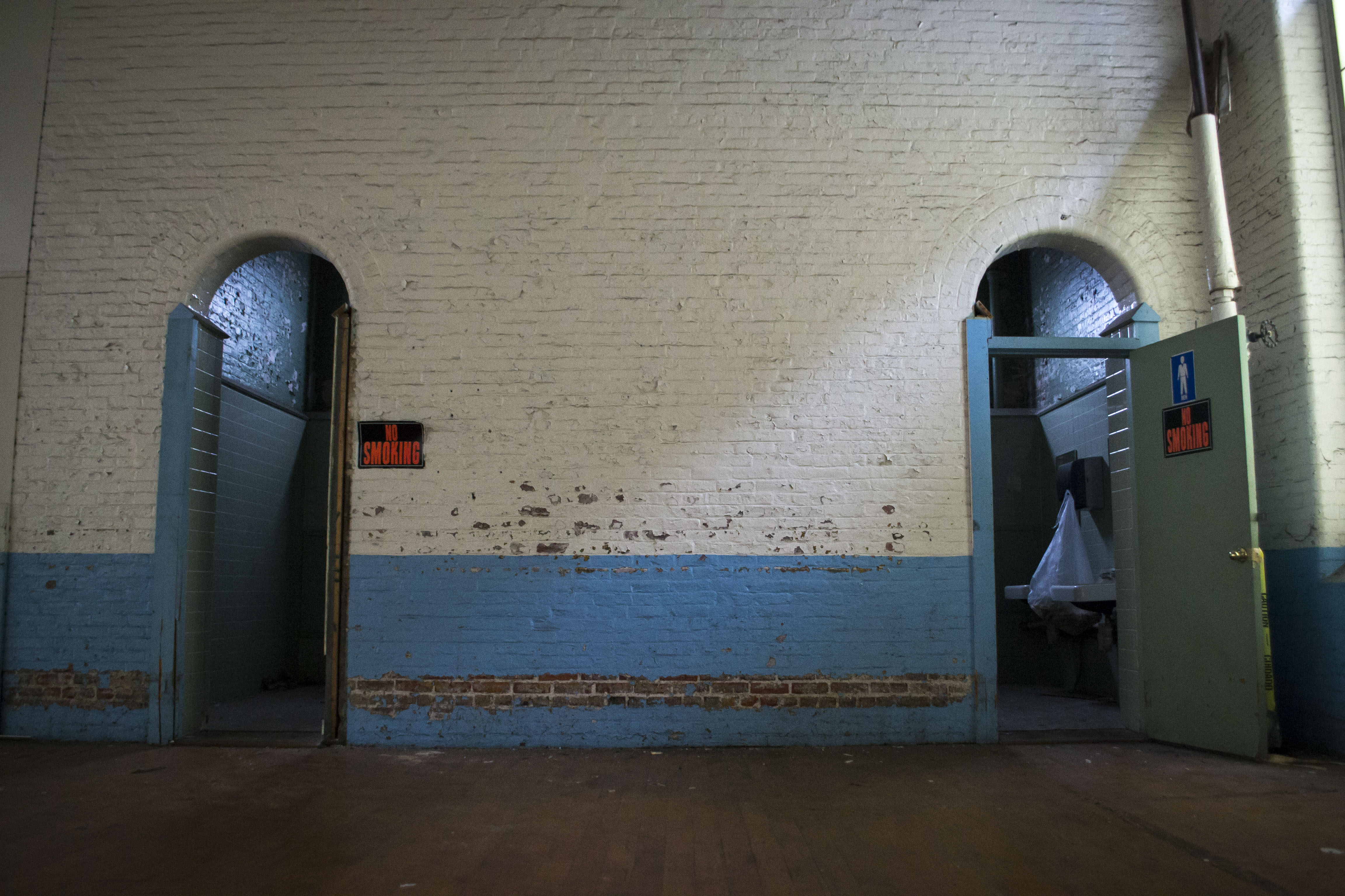 In its hey day, the Pepperell Mill employed 1,800 people, many of them from foreign countries. The first thing they were taught, Guillerault said, was how to find the bathrooms when they were working, easily identified by these signature arched doorways. ALAN BENNETT/Journal Tribune