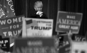 """REPUBLICAN presidential candidate Donald Trump gestures during a campaign state at the University of Wisconsin-Eau Claire in Eau Claire, Wisconsin. In his victory speech, Trump called them America's """"forgotten men and women"""", the workers from the coalfields of Appalachia to the hallowing manufacturing towns of the Rust Belt who propelled him to an improbable victory. They felt left behind by progress, laughed at by the elite, and so put their faith in the billionaire businessman with a sharp tongue and short temper."""