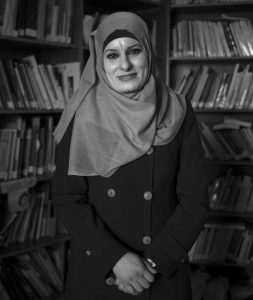 PALESTINIAN DIVORCE LAWYER REEMA SHAMASNEH poses for a photo in the office of her legal aid center in Ramallah, West Bank. One divorce at a time, the Palestinian lawyer fights for female clients in an Islamic family court where a man's testimony is worth twice a woman's. Shamasneh, a devout Muslim, believes the laws are the way they are because they were passed by men. She shuns traditional marriage for herself, saying she can take care of herself.