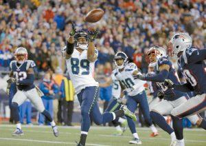 SEATTLE SEAHAWKS WIDE RECEIVER Doug Baldwin (89) catches a pass for his third touchdown of the game during the second half of an NFL football game against the New England Patriots on Sunday in Foxborough, Mass.