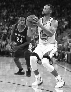 GOLDEN STATE WARRIORS GUARD Stephen Curry, right, shoots as New Orleans Pelicans' Buddy Hield (24) watches during the second half of an NBA basketball game on Monday in Oakland, Calif. Curry hit 13 3-pointers in Golden State's 116-106 victory.