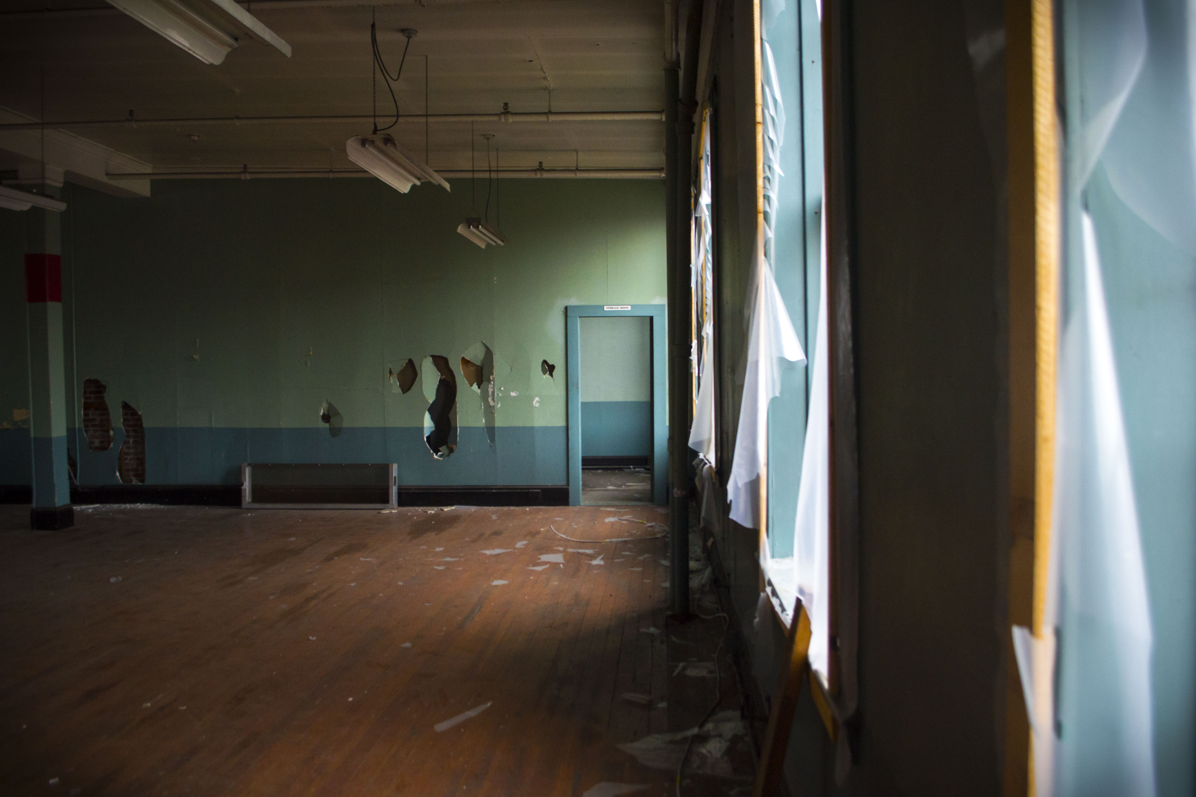 A room in 19 Mill, formerly the home of office space for order processing, now sits, battered. ALAN BENNETT/Journal Tribune