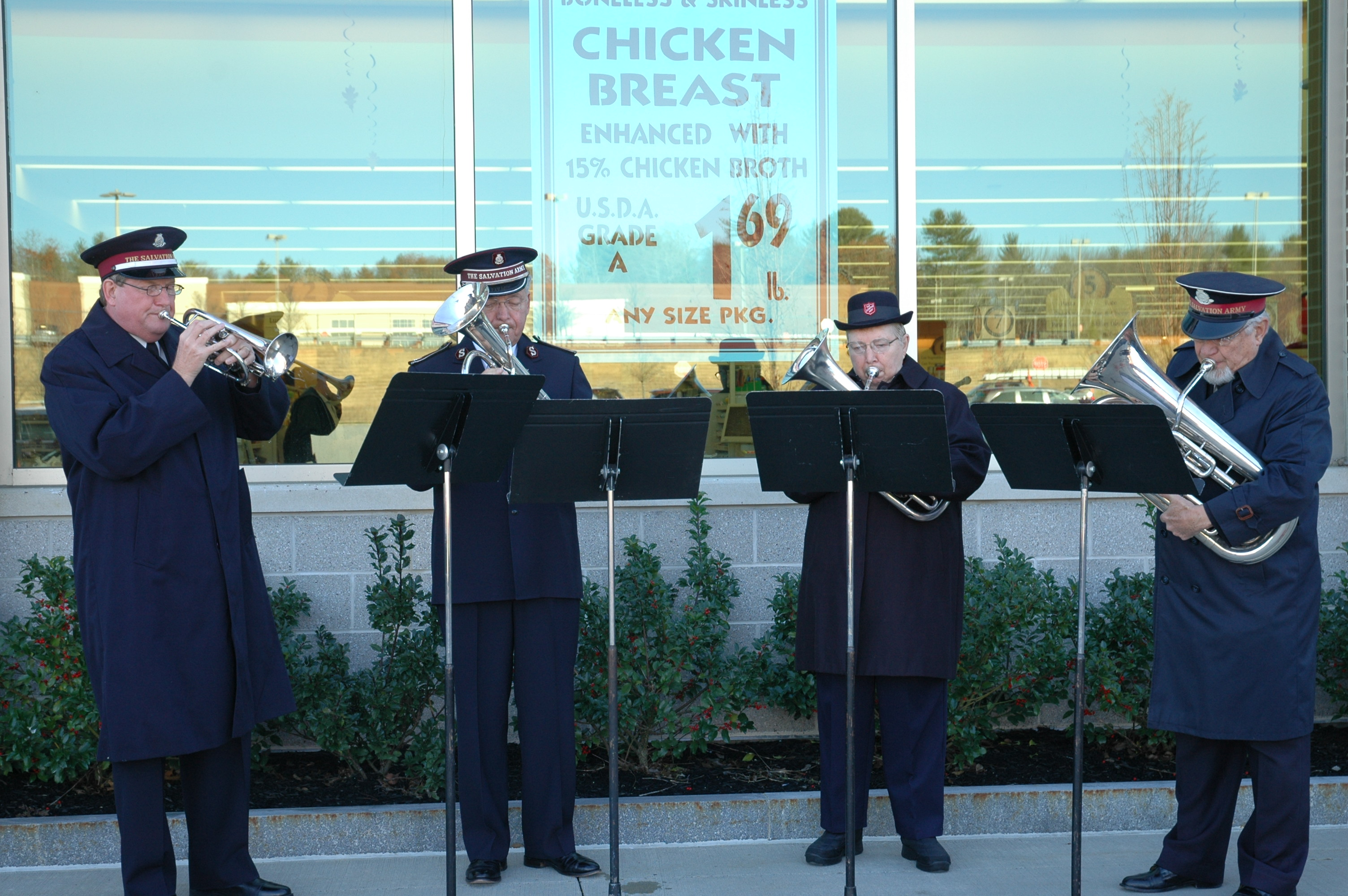 The Salvation Army Brass Ensemble performs at the Red Kettle Christmas Campaign kick off in front of Market Basket in Biddeford Saturday.
