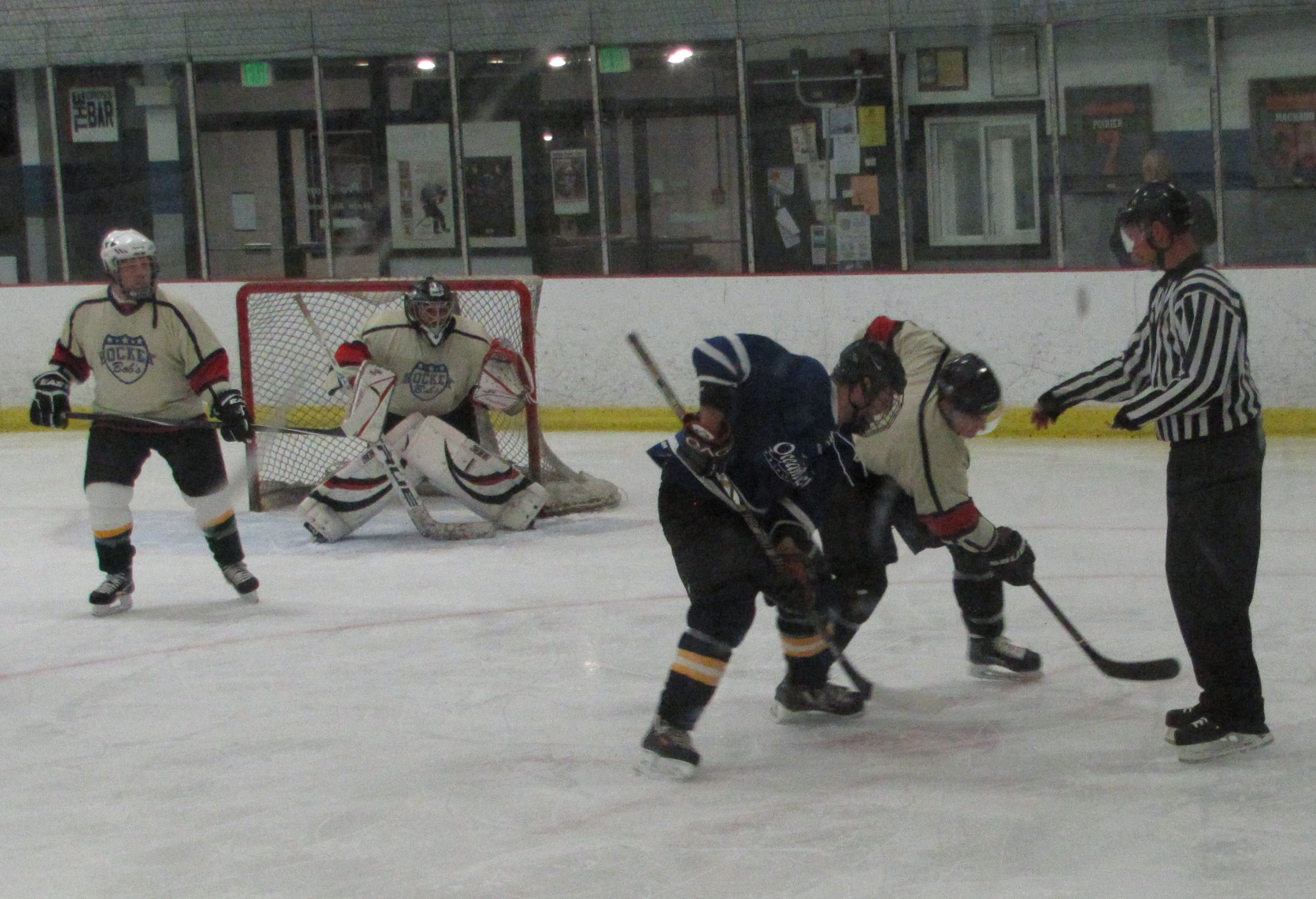 TAYLOR MORRISON/JOURNAL TRIBUNE: Hockey Bobs and Albert's Garage face off in Bob's zone Wednesday night. Hockey Bobs came back from a late start to win, 9-3.