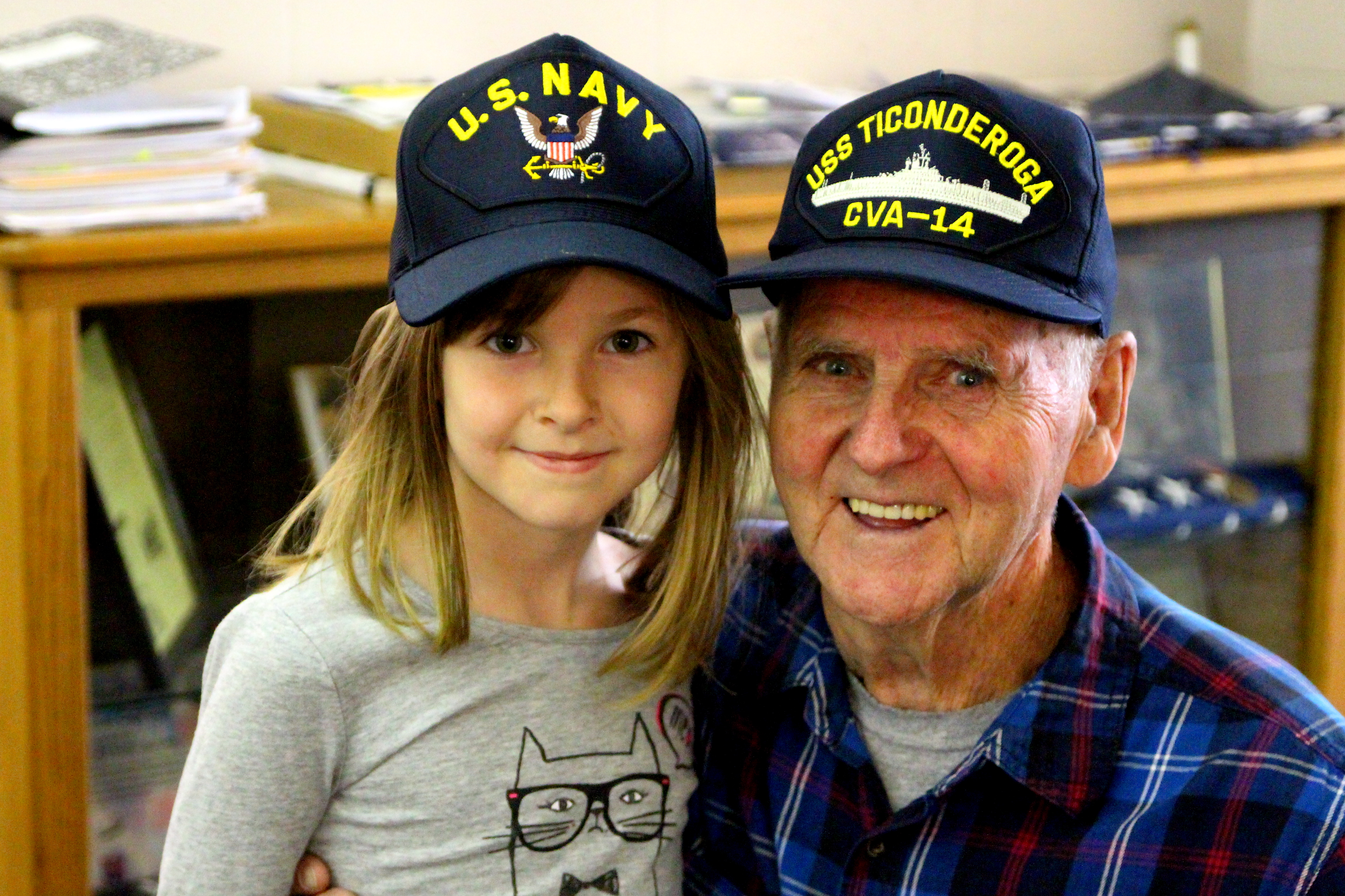 Belinda Rivard, a second grade student at Margaret Chase Smith School in Sanford got a hug from her grandfather, U.S. Navy veteran Ron Rivard, at a special ceremony at the school honoring veterans Wednesday. TAMMY WELLS/Journal Tribune