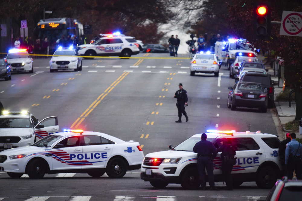 Police secure the scene near Comet Ping Pong in Washington, Sunday, Dec. 4, 2016. A man who said he was investigating a conspiracy theory about Hillary Clinton running a child sex ring out of the pizza place fired an assault rifle inside the restaurant on Sunday injuring no one, police and news reports said.