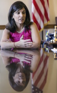Speaker of the Maine House Sara Gideon speaks to a reporter at her State House office.