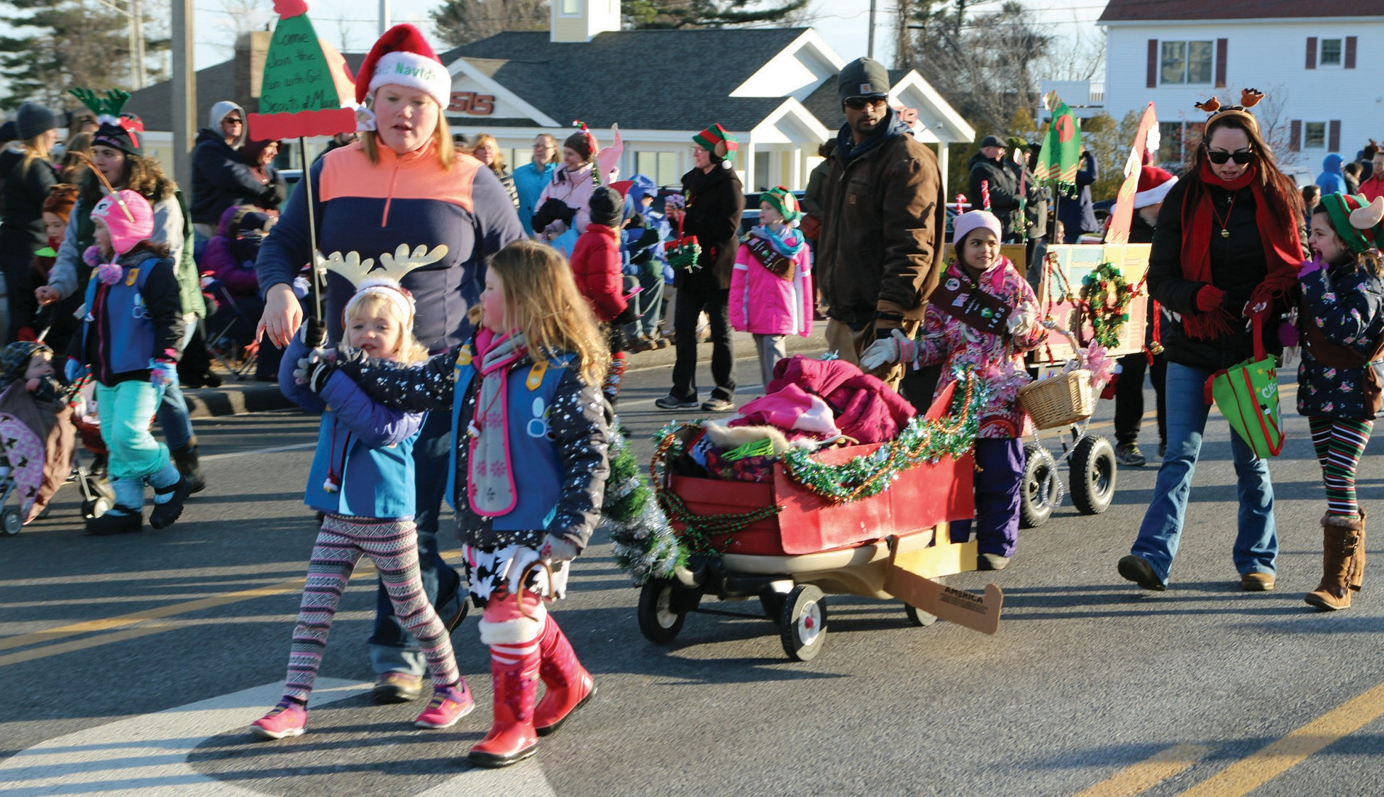 Many adults and kids marched in the Wells Christmas parade Sunday afternoon. //TAMMY WELLS/Journal Tribune