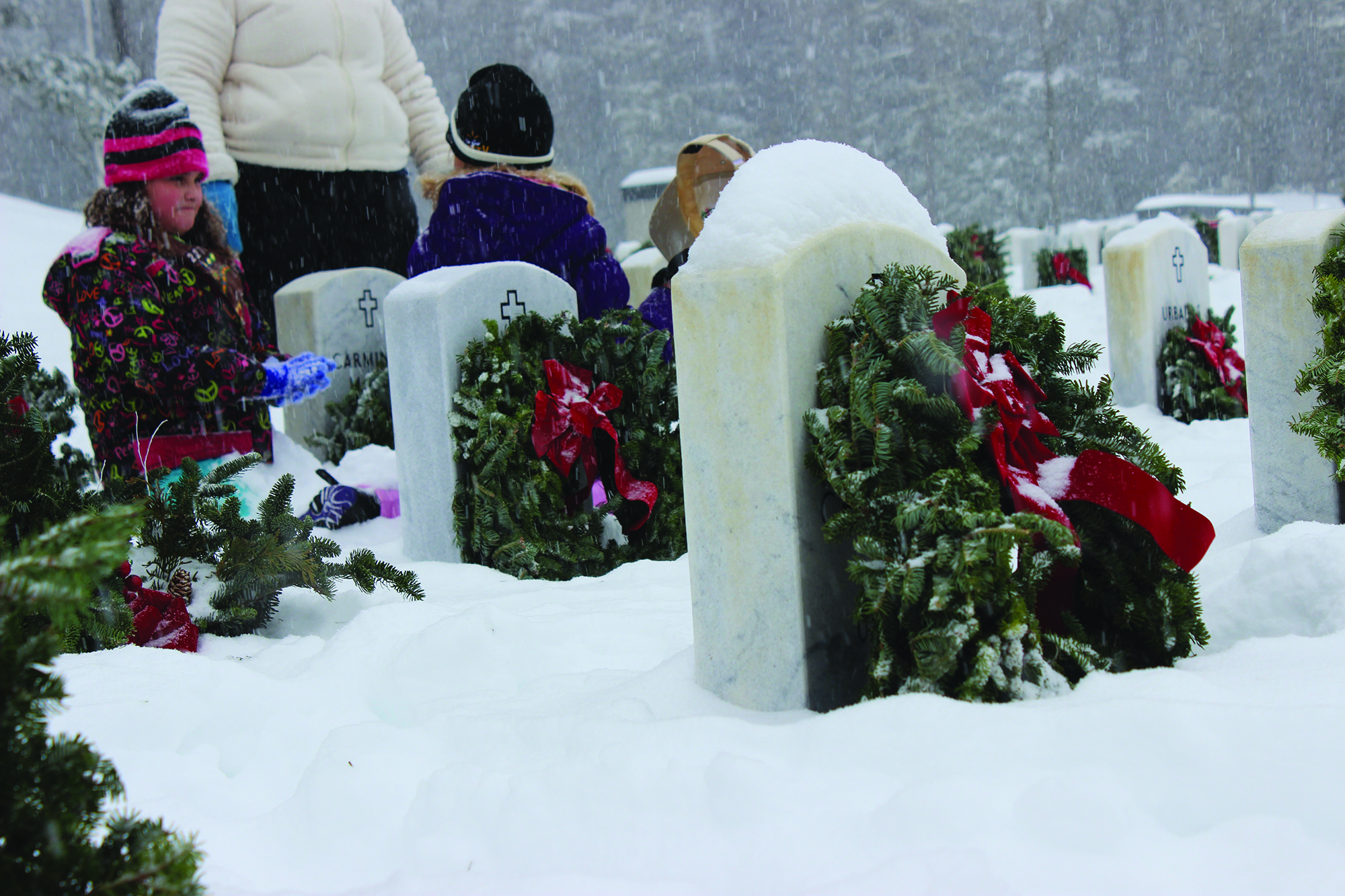 Children play in the snow during the Wreaths Across America event in Springvale on Saturday. RYDER SCHUMACHER/Journal tribune