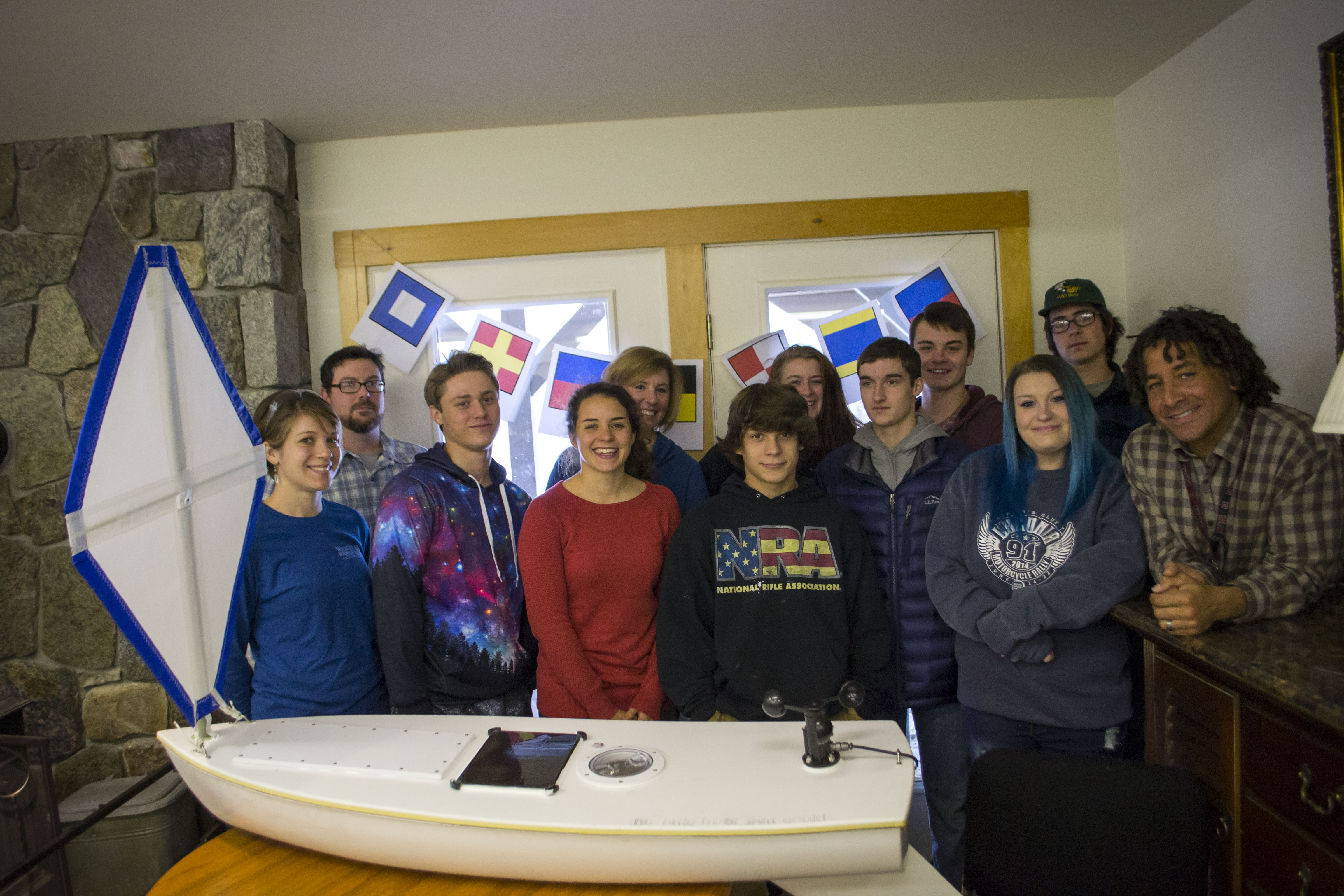 Students from Kennebunk High School's Alternative Education program, the Landing School in Kennebunkport and members of the Kennebunkport Conservation Trust stand with their boat,
