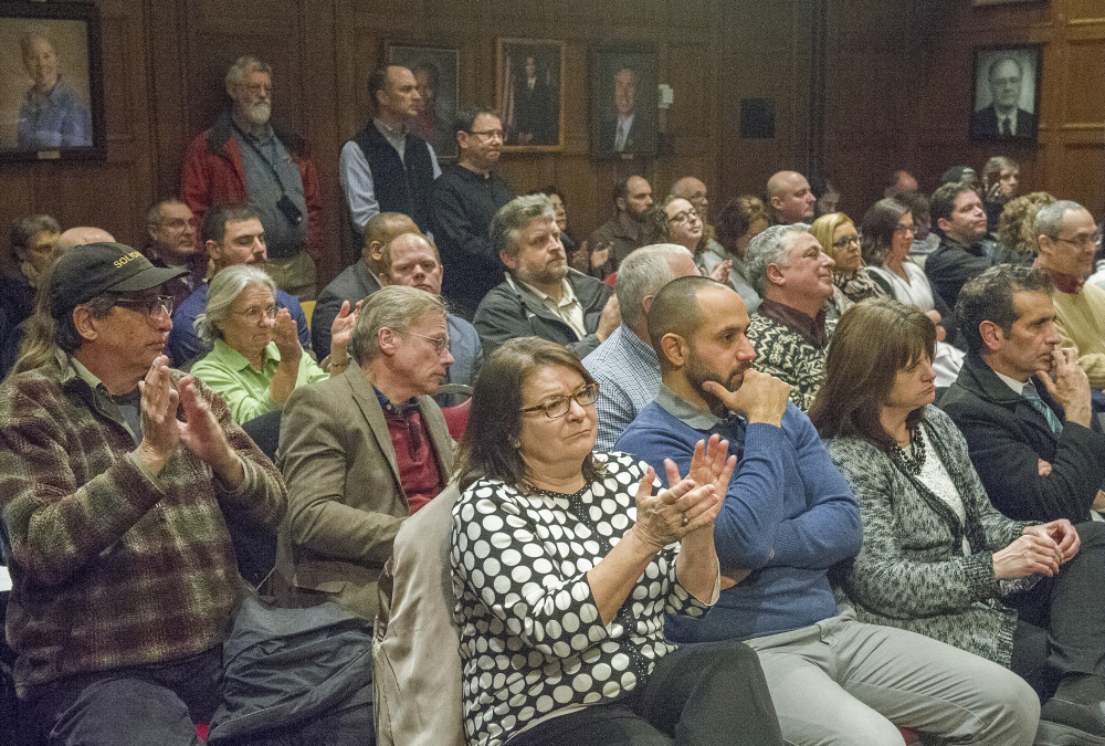 Audience members have a mixed response to a point made by Mayor Ethan Strimling during his address in council chambers.