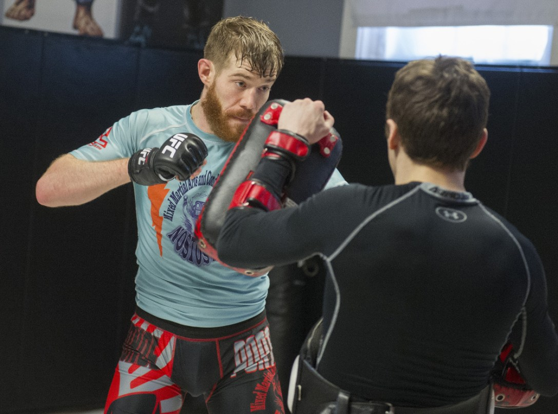 Devin Powell spars with Muay Thai teacher Tim Hagan, one his main training partners, during a recent workout at his Nostos MMA training facility in Somersworth, New Hampshire.