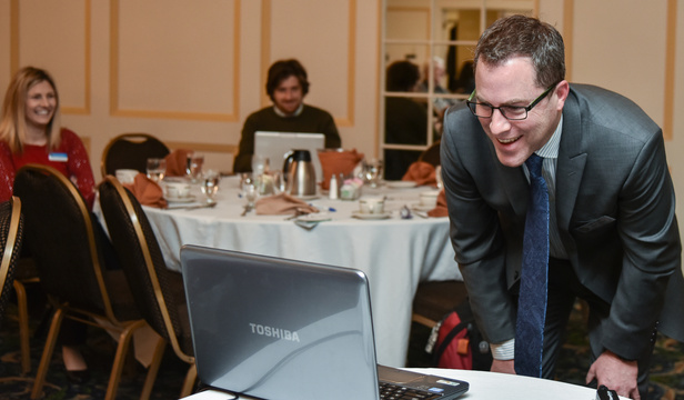 Kennebec Valley Chamber of Commerce board member Alec Rogers asks guest speaker Patricia Rosi a question Wednesday as she is connected remotely at the chamber's Business Insider Breakfast at the Senator Inn & Spa in Augusta. Rosi is the chief executive officer of Wellness Connection of Maine, which runs four medical marijuana dispensaries in the state.