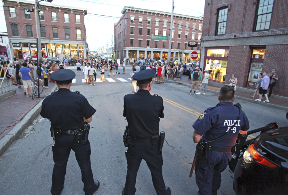 Police keep their distance on Pearl Street as about 150 people rally on Commercial Street in Portland for a July 15, 2016 Black Lives Matter event.