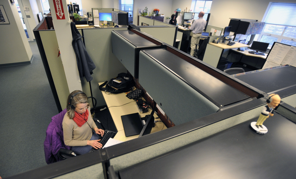 Patty Wight, a health reporter with Maine Public Radio, works in the newsroom Friday.