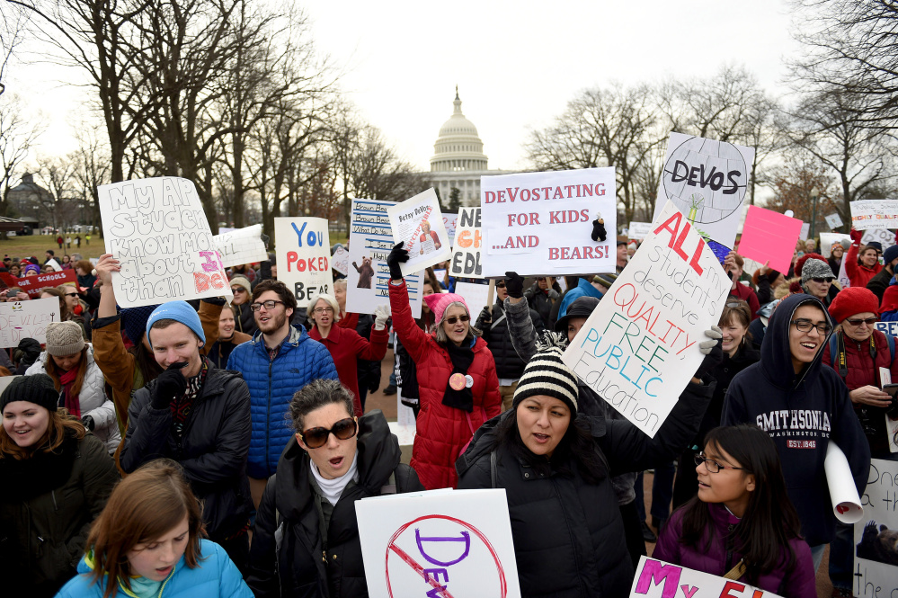 A crowd rallies Sunday on Capitol Hill to protest the nomination of Betsy DeVos as secretary of education. Similar protests took place over the weekend in Portland, Ore., Nashville and Holland, Mich., DeVos' hometown.