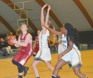 SYDNEY UNDERHILL-TILTON of Richmond goes up to the basket with Madison Hughes (10) and Patricia Mudogo (5) of Hyde defending. Underhill-Tilton finished with 18 points.