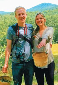 RACHEL LINKOUS, with Christopher Rannefors, both 25, of Lexington, Kentucky, shows off the engagement ring after he proposed in June while the two foraged for wild mushrooms, flowers and herbs near Asheville, North Carolina.