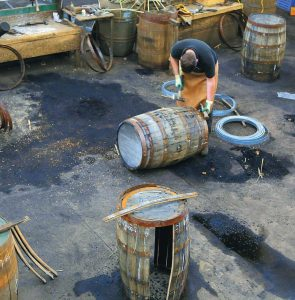 ABOVE, A WORKER at the cooperage of the Balvenie distillery in Dufftown, in the Speyside region of Scotland, works on a whisky barrel. The distillery also has a working malting floor and offers tours and tastings.