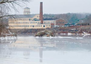 BOWDOIN MILL ISLAND is reflected in the glossy Androscoggin River ice, as seen last week in this photograph taken by Steve Trockman.