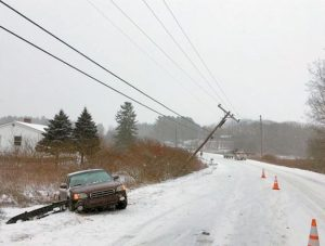 POWER WAS OUT for nearly five hours after a car lost control on the snow covered road and hit a utility pole on Route 24 in Topsham near the Bowdoinham town line Wednesday morning.