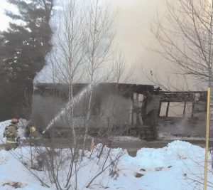 FIREFIGHTERS EXTINGUISH A BLAZE at a home near Durham Community School on Wednesday.