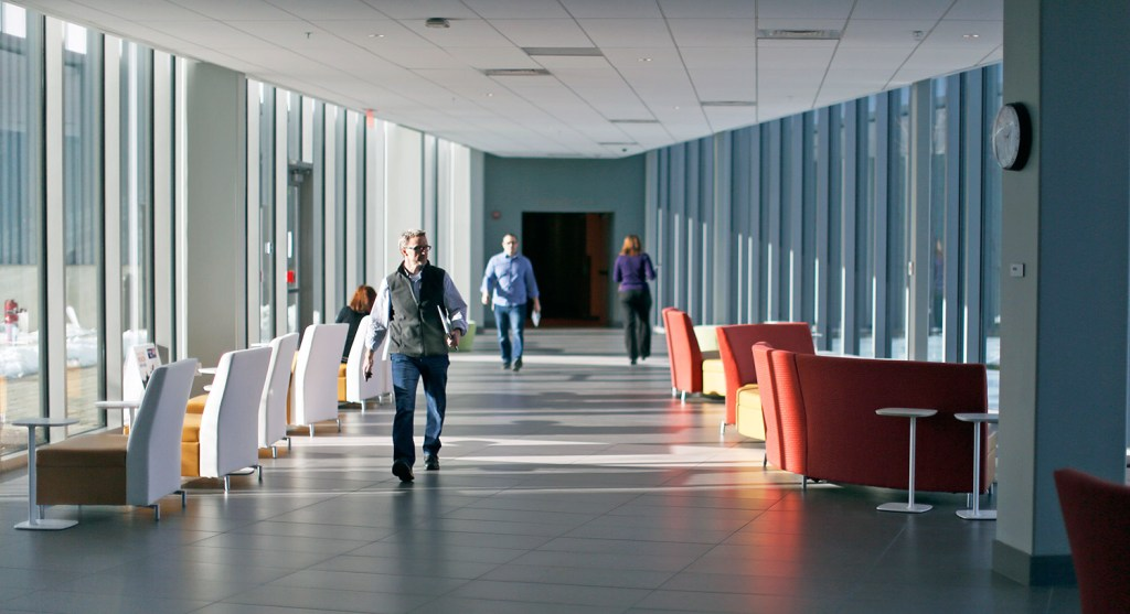 Employees at Idexx Laboratories walk down a corridor at the Westbrook campus. The company has been added to the S&P 500. Ben McCanna/Staff Photographer