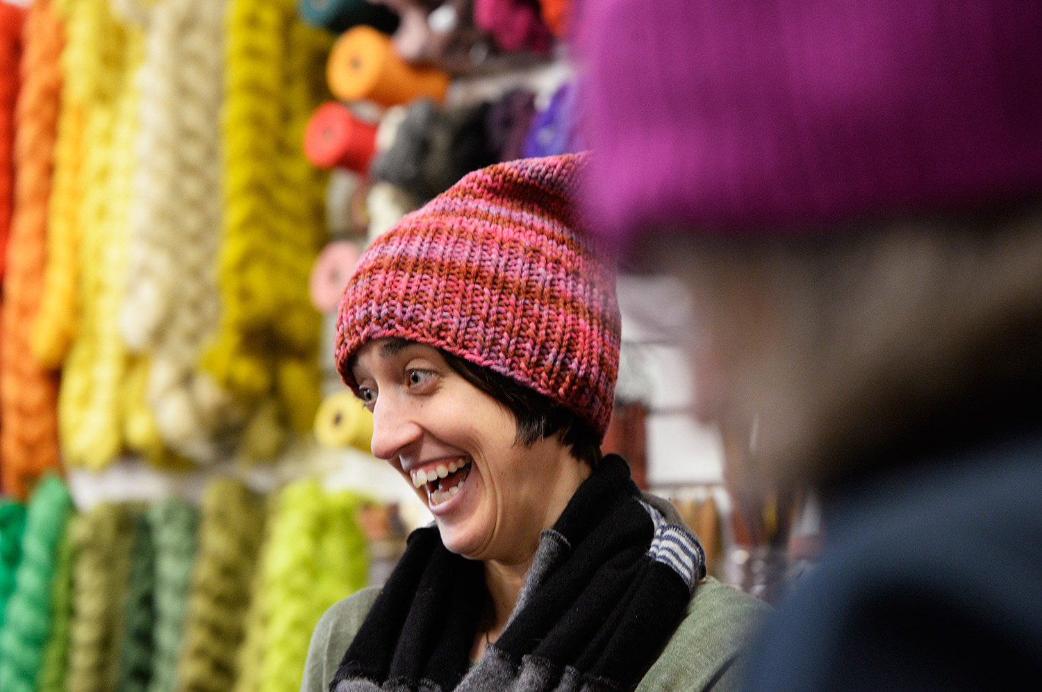 Wearing a pink pussy hat, Casey Ryder of Portland laughs with a spinning group at PortFiber on Thursday. Women are knitting the hats to wear to the Women's March on Washington on Jan. 21, and Ryder is planning to march.