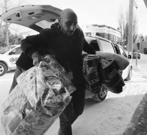 FADEL ALSHAWWA, Manitoba Interfaith Immigration Council, brings blankets into a community hall for refugees that may walk across the border in Emerson, Manitoba, Thursday. Refugees have been crossing into Canada at Emerson and authorities had a town hall meeting in Emerson to discuss their options.