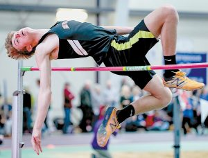 BRUNSWICK HIGH SCHOOL'S Ryan Olson competes in the high jump during the State Class A Indoor Track and Field Championships at the University of Southern Maine in Gorham on Monday. Olson finished in a tie for third place.