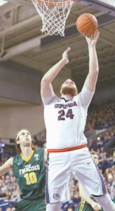 GONZAGA center Przemek Karnowski (24) shoots against San Francisco forward Matt McCarthy (10) during the first half of an NCAA college basketball game in Spokane, Wash., om Thursday. Top-ranked Gonzaga rolled to a 96-61 victory.
