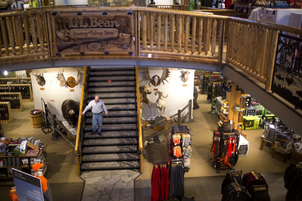 An employee walks down the staircase in the Hunting and Fishing store at the flagship L.L. Bean campus in Freeport on Thursday. L.L. Bean is offering early retirement packages to about 900 employees with the goal of downsizing by 10 percent of its U.S. workforce in order to free up cash to invest in expansion and automation.