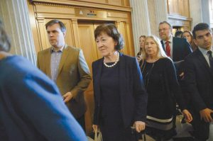 SEN. SUSAN COLLINS, R-Maine, center, arrives at the Senate chamber on Capitol Hill in Washington in this Feb. 7 photo. Collins said Wednesday that she's open to using a subpoena to investigate Republican President Donald Trump's tax returns for potential connections to Russia.