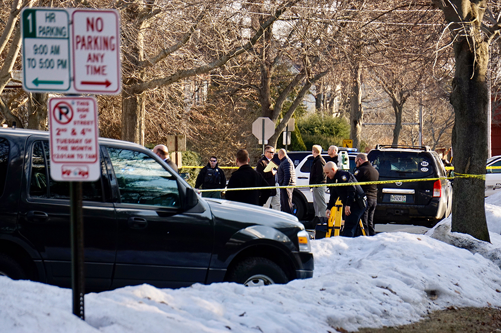 Portland Police crowd the scene on Chadwick Street in the city's West End where a man died Monday afternoon. Police are classifying the man's death as a homicide.