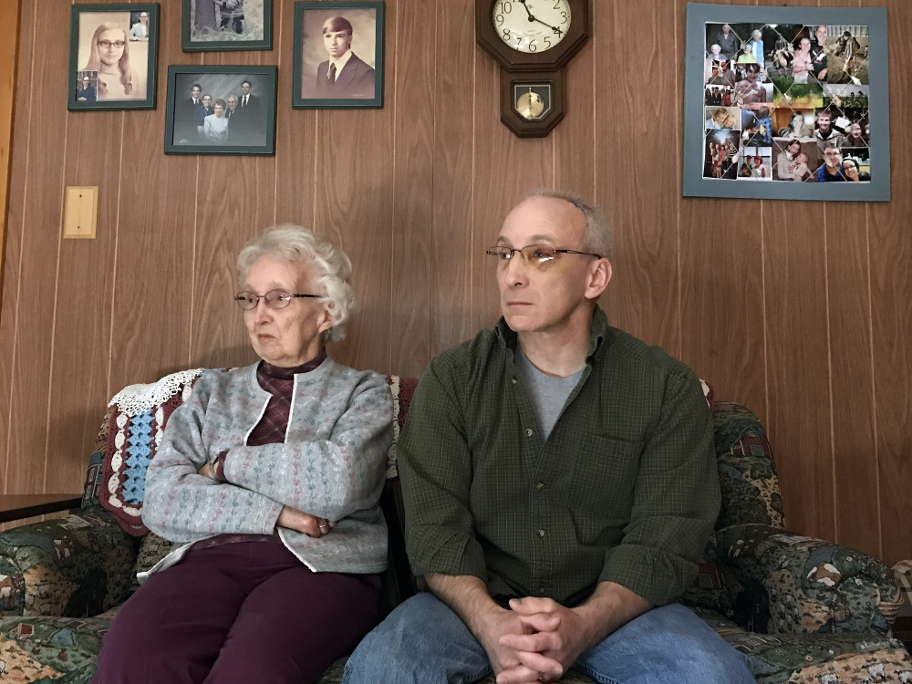 Audrey Hewitt and her son Eric Hewitt take part in an interview Friday in Audrey Hewitt's Sidney home.
