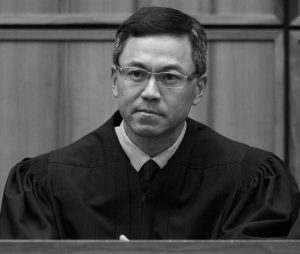 U.S. DISTRICT JUDGE DERRICK WATSON in Honolulu. Watson heard arguments Wednesday, in Honolulu, on whether to extend his temporary order blocking President Donald Trump's revised travel ban. But even if Watson doesn't put the ban on hold until the state's lawsuit is resolved, his temporary block would remain until he rules otherwise.