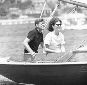 IN THIS AUG. 7, 1960, photo, Sen. John F. Kennedy and wife, Jacqueline, sail in the family sailboat, Victura, off the Cape Cod shore at Hyannis, Massachusetts.