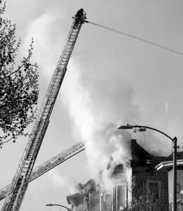 FIREFIGHTERS BATTLE an early morning apartment fire Monday in Oakland, California.