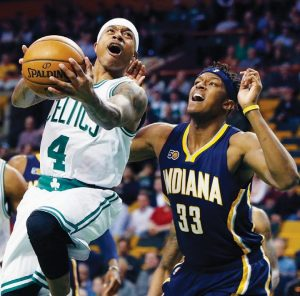 BOSTON CELTICS GUARD Isaiah Thomas (4) goes up to shoot against Indiana Pacers' Myles Turner (33) during the first quarter of an NBA basketball game in Boston on Wednesday.