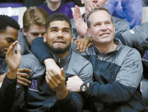 NORTHWESTERN COACH CHRIS COLLINS, right, and guard/forward Sanjay Lumpkin react while watching television coverage of the NCAA men's basketball tournament selection show on Sunday at Welsh-Ryan Arena in Evanston, Ill. Northwestern, in its first-ever tournament appearance, will play Vanderbilt.